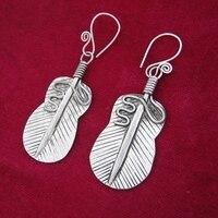 Guizhou Miao ethnic jewelry ethnic retro earrings Hanfu accessories handmade Miao silver earrings banana fan