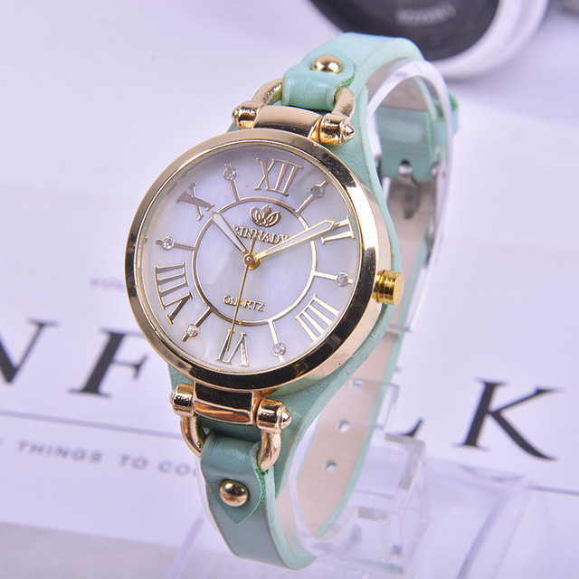 c5571d4bf78ac Fashion Brand RINNADY High Quality Dress Watch Women Lady Analog Quartz  Wrist Watches Leather Strap Girls Clock Relogio Feminino