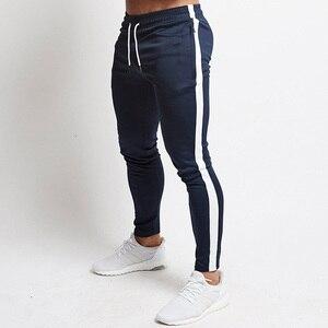 Image 1 - Kırmızı koşu pantolonları erkek çizgili spor Sweatpants pantolon çalışan spor salonu pantolonu erkekler pamuk eşofman spor Jogger vücut geliştirme pantolon