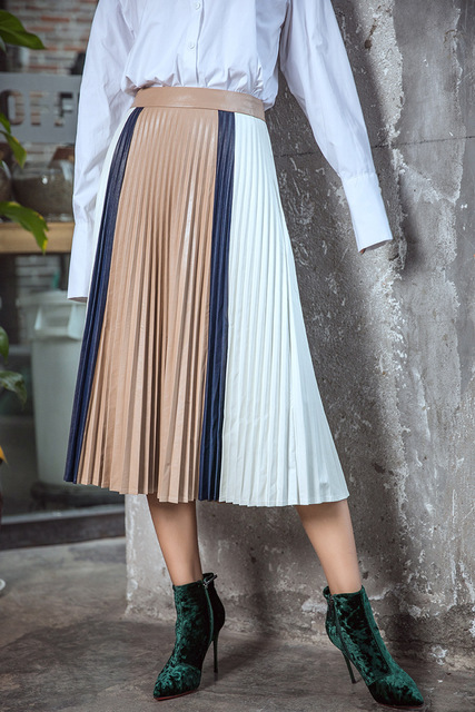 a021d706e Women PU Pleated Skirts New Patchwork color Skirt European and America  Style Mid-Calf Leather