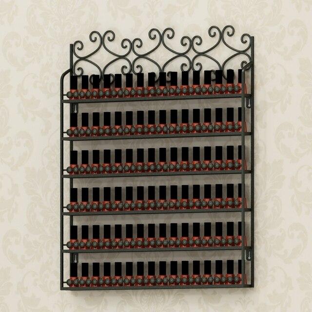 Pared de hierro forjado colgando uñas estante de exhibición. Uñas de ...