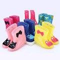 Niños primavera otoño invierno niños niñas bebé niños rinoceronte de color caramelo con rana cat conejo botas de lluvia impermeable del zapato