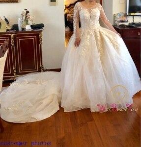 Image 5 - Robe de mariée en dentelle avec des appliques en boule avec des appliques, couleur Champagne, Train cathédrale, manches trois quarts