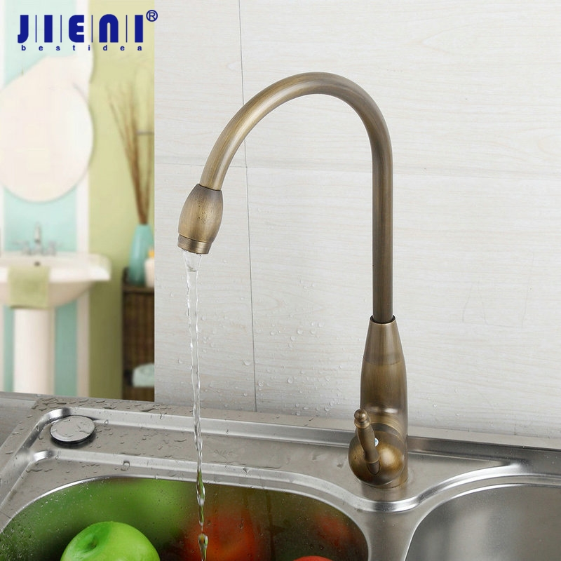 цены на JIENI Antique Brass Kitchen Tap Basin Faucet Ceramics Handle Chrome Ceramic Plate Spool Hot Cold Water Mixer Kitchen Faucet в интернет-магазинах