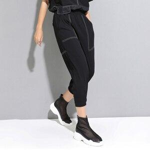 Image 2 - [EAM] 2020 New Spring Autumn High Elastic Waist Line Split Joint Loose Pocket Harem Pants Women Trousers Fashion Tide JW598