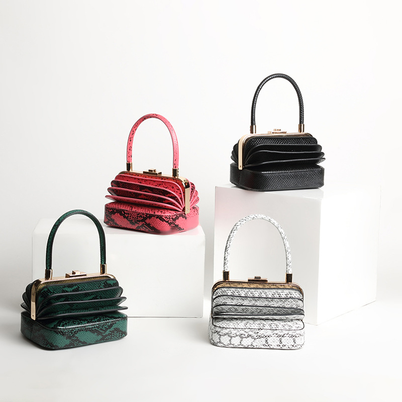 2018 new serpentine custom personality design catwalk niche models retro unique portable organ genuine leather handbags 18 years in europe and the united states new custom personality design show small retro unique portable organ leather handbags