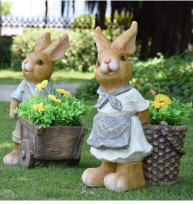 Outdoor cartoon rabbit flower jar. Sculpture of garden landscape sculpture. Simulation of animal decoration