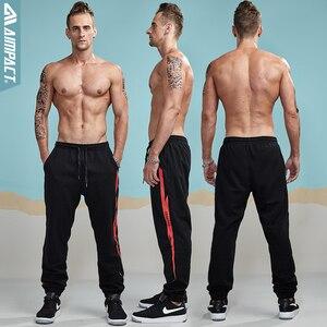 Image 2 - Aimpact 2018 nowy na co dzień Jogger spodnie męskie aktywny elastyczny miejskich Biker spodnie męskie bawełniane sznurek spodnie dresowe męskie śledzić spodnie AM5003