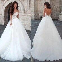Atrakcyjne Tulle Bateau dekolt suknia balowa suknie ślubne z koronkowymi aplikacjami Backless suknie ślubne Robe De Mariage