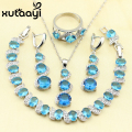XUTAAYI 4PCS Jewelry Set 925 Sterling Silver Fetching AlluringBlue Created Topaz Earrings Ring Necklace Pendant Bracelet