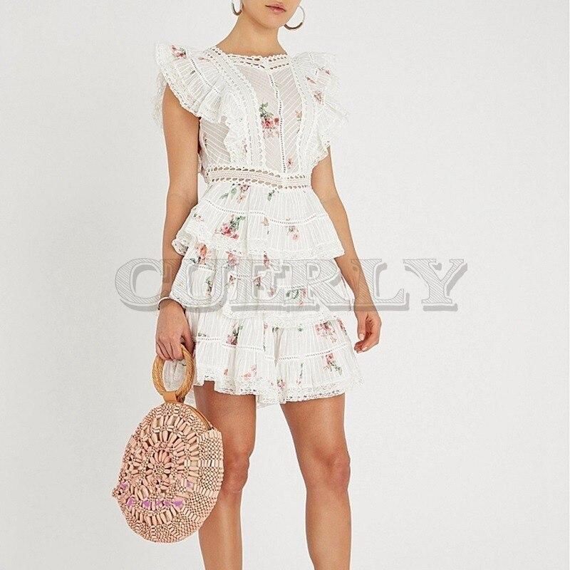CUERLY 2019 été femmes dos nu arc Mini gâteau plage robe fleurs imprimer sans manches volants robes de soirée verano robe femme