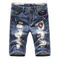 2016 Good quality men's Big hole patch Slim short Jeans New fashion summer Cotton Male Light Blue Casual denim shorts Size 36