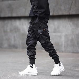 Image 3 - Pantalones lápiz negros de Hip Hop para hombre, ropa de calle, bombachos con bolsillos, para correr, a la moda, para Primavera, 2019, cinta HD070