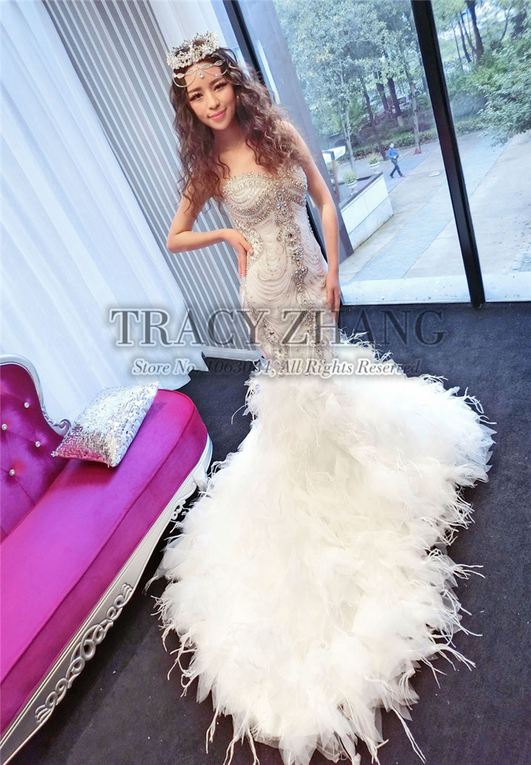 Luxury Full Rhinestone Bead Corset Feather Train Bride Bridal Mermaid Gown Dress Y Slim Custom Wedding Dresses With Crystals في