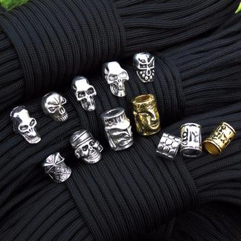 5 sztuk partia Paracord koraliki metalowe Charms czaszka dla Paracord bransoletka akcesoria Survival DIY wisiorek klamra na nóż smycze tanie i dobre opinie Paracord Bracelet Accessories