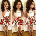 2015 moda de verano al por menor 2-6Y ropa de las muchachas 2 unids ropa de los cabritos sin mangas camiseta blanca + rose floral tutu falda de la muchacha que arropan el sistema