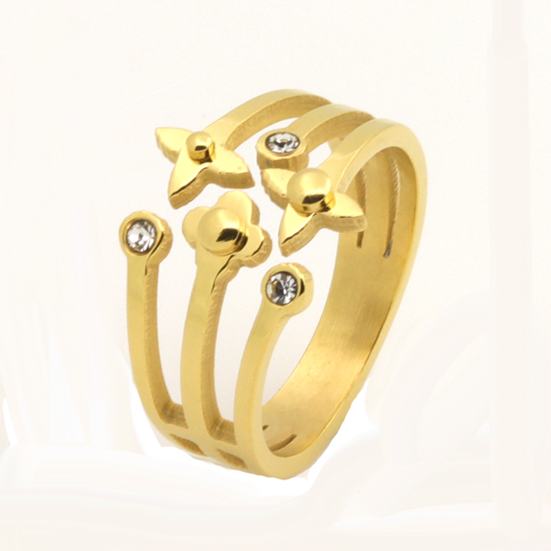 高品質の有名なブランドの花とスターデザインクリスタルリングゴールドカラーステンレススチール高級ジュエリー用女性の結婚指輪