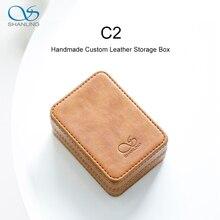 صندوق تخزين جلدي مخصص مصنوع يدويًا من شانلينغ C2 لسماعات ME100 صندوق ضغط محمول