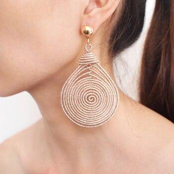 Boucles d'oreilles bohème spirale ronde Boucles d'oreilles Bella Risse https://bellarissecoiffure.ch