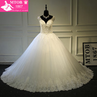 Luxury Shiny Crystals Beading Pearls Puffy Ball Gowns Sweetheart Sexy Deep V Backless Wedding Dresses Real
