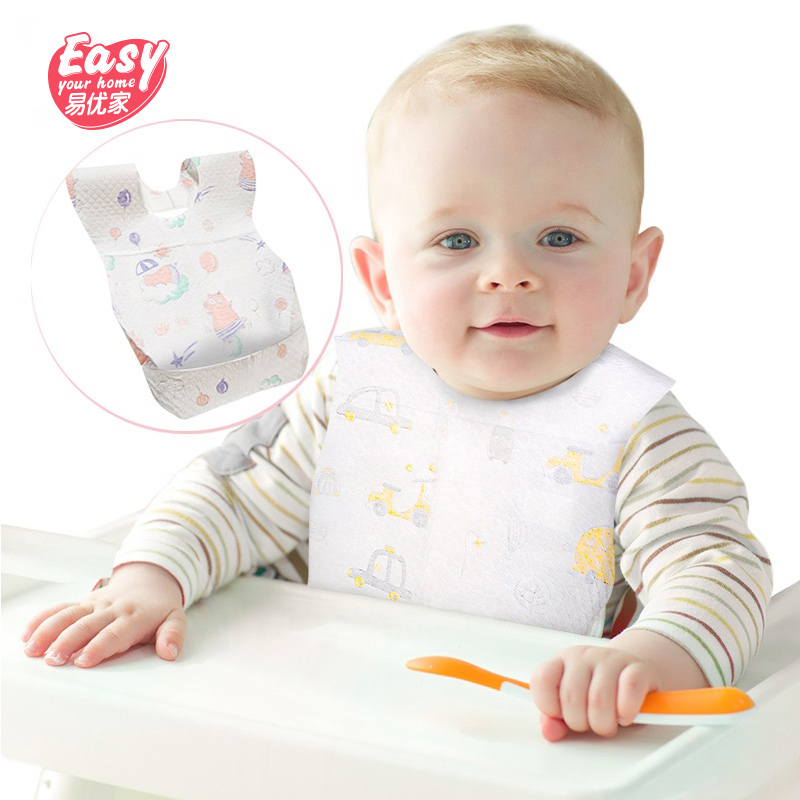 20Pcs lot Disposable Waterproof Non Woven Baby Bibs Cartoon Feeding Saliva Apron Paper Baby Bibs in Aprons from Home Garden