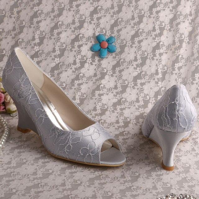 Wedopus MW858 Escarpins /à enfiler bout ferm/é Talon moyen en dentelle unie Chaussures de mariage