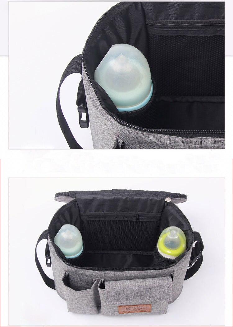 HTB1lfJ4di6guuRkSmLyq6AulFXaD Diaper Bag Baby Stroller Organizer Hanging Nappy Bag Large Capacity Travel Backpack Pram Buggy Cart Waterproof Maternity Bag