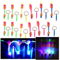 12Pcs/Lot Amazing LED Light Arrow Rocket Helicopter Rotating Flying Toy Party Fun Kids Outdoor Flashing Toy Fly Arrow