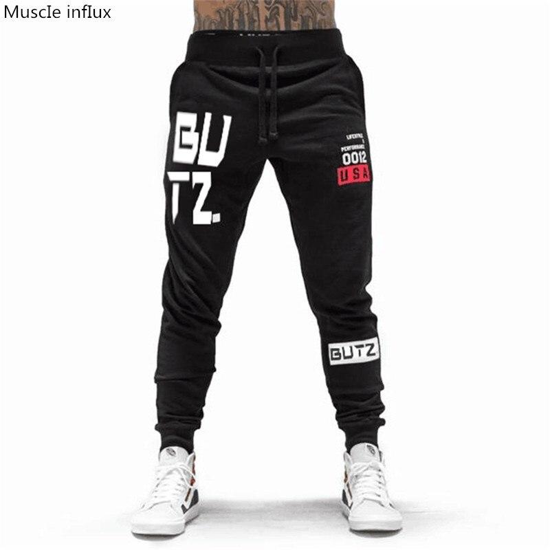 2018 Autumn Brand Gyms Men Joggers  workout cotton trousers Casual fashion sportswear Pencil pants