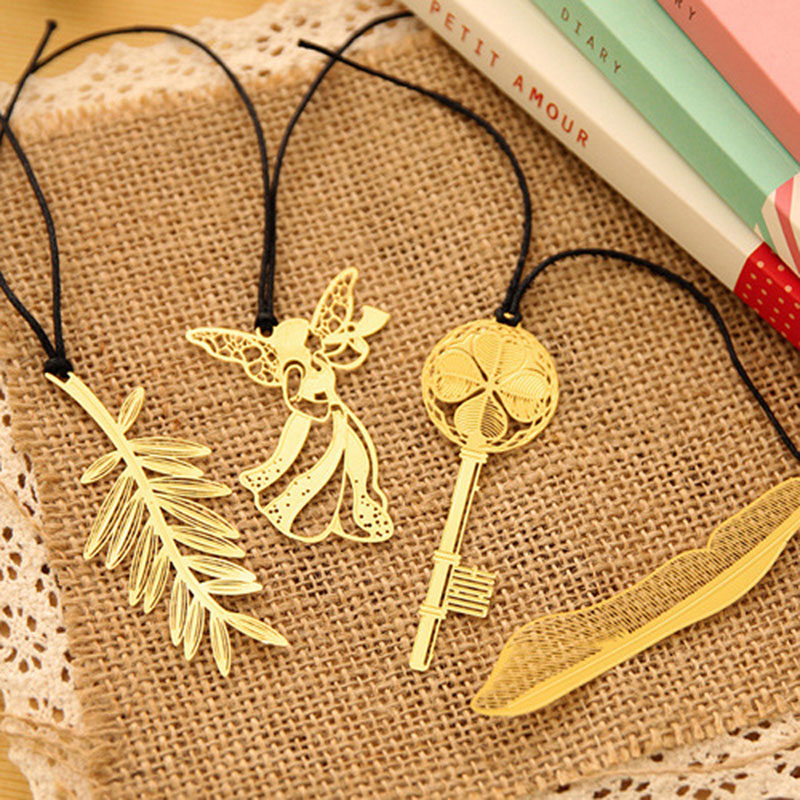 Купить с кэшбэком 4pcs/box creative Cute Super delicate mini metal bookmark art design  Feather angel key bookmarks Kawaii Cartoon Gift