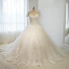 Robe de mariée luxe à pailletes et perlé ...