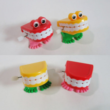 12Units/lot Free Shipping Clockwork teeth Novelty toys Walking Jumping Wind-up on the chain Creative toy for Kid Best Gift