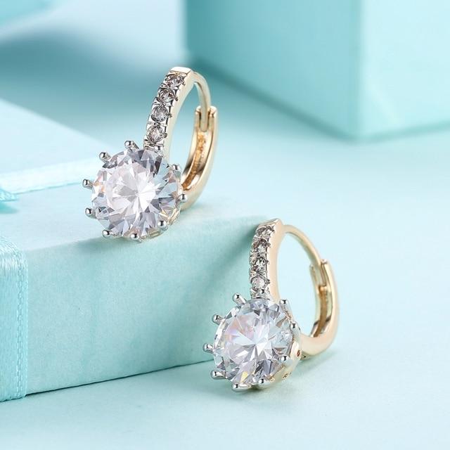 Фото женские серьги гвоздики с фианитами золотистые кристаллами в цена