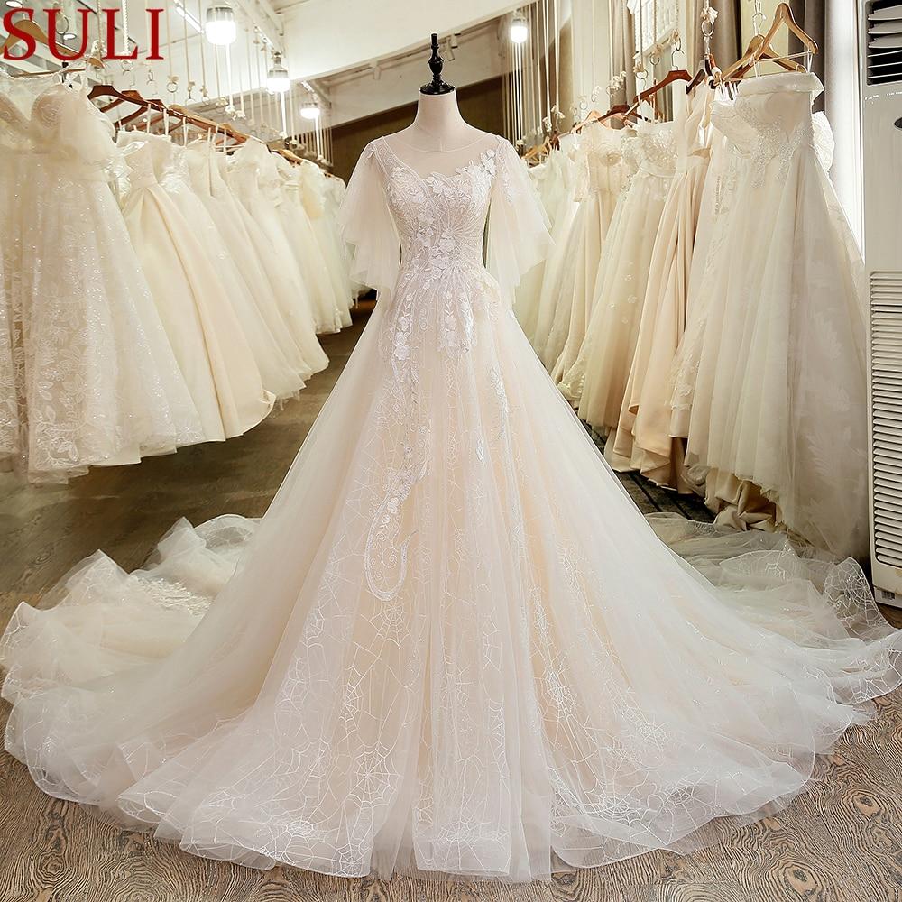 SL 6044 Elegant Illusion Bodice Lace Puffy Short Sleeve Wedding Dress 2019 Cheap Long Train Backless
