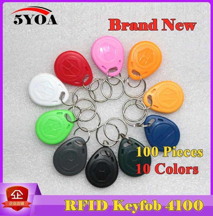 imágenes para 100 Unids EM4100 125 khz ID Keyfob RFID Tag Etiquetas llaveros llavero Porta Etiqueta Tarjeta De Chave Llavero Token Ring Chip de proximidad
