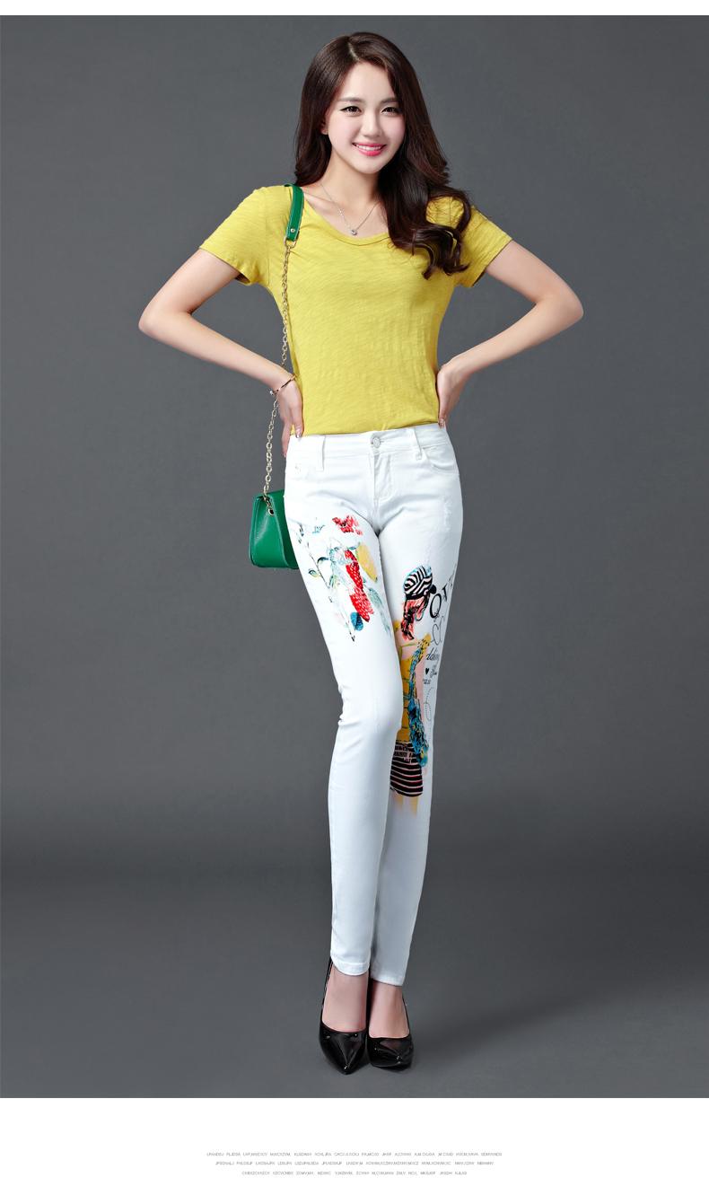 Valged teksapüksid värviliste detailidega