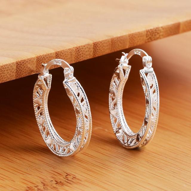 Фото серьги женские модные серебристые высокого качества ажурные цена