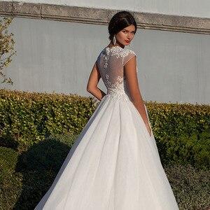 Image 4 - Vestidos de novia Ballkleid Weiß Schatz Appliques Cap Sleeve Braut Kleider 2019 Billige Kunden Spitze Backless Hochzeit Kleider