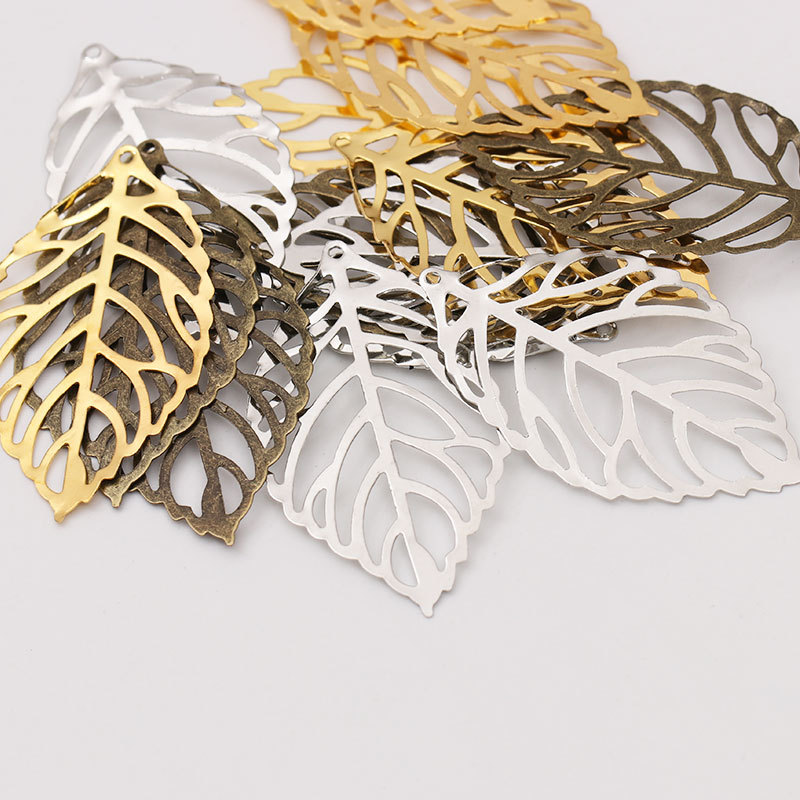 50pcs Craft Hollow Leaves Pendant Jewelry Accessories Gold Charm Filigree Jewelry Making Plated Vintage for Hair Comb Hot New in Charms from Jewelry Accessories