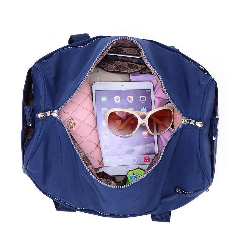 Jinqiaoer Merek Kapasitas Besar Portabel Bagasi Fashionable Perjalanan Tahan Air Nylon Multi-Fungsi Tas Bahu Tas Tangan Wanita