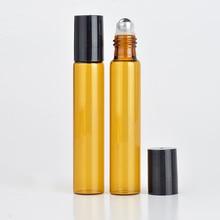 Venta al por mayor 100 unids/lote 10 ML rollo en portátil de vidrio ámbar botella de perfume recargable vacía caja de aceite esencial con tapa de plástico