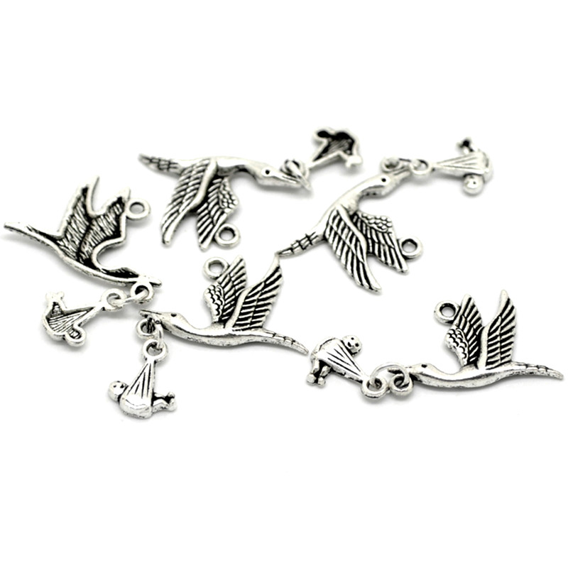 100Pcs Silver Tone Flying Stork Bird With Dangling Baby Metal Pendants Fashion Jewelry Findings Charms 17x10mm