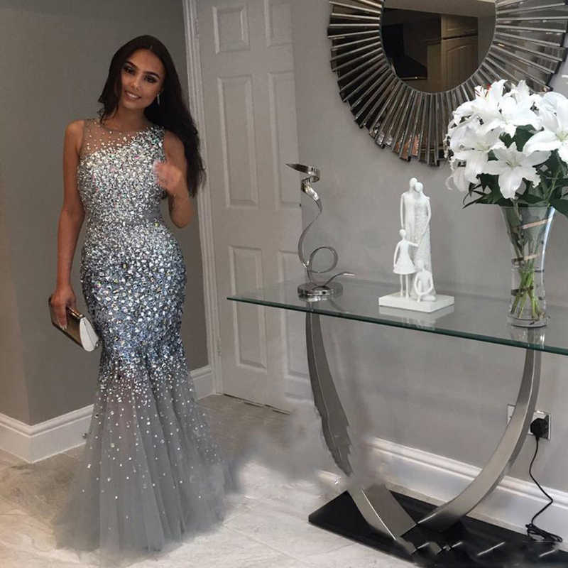 2018 Glittering Mermaid Prom Gowns Sheer Neck Sleeveless Crystal Beaded  Tulle Mermaid Evening Gowns Formal Party 88f58dd336a1