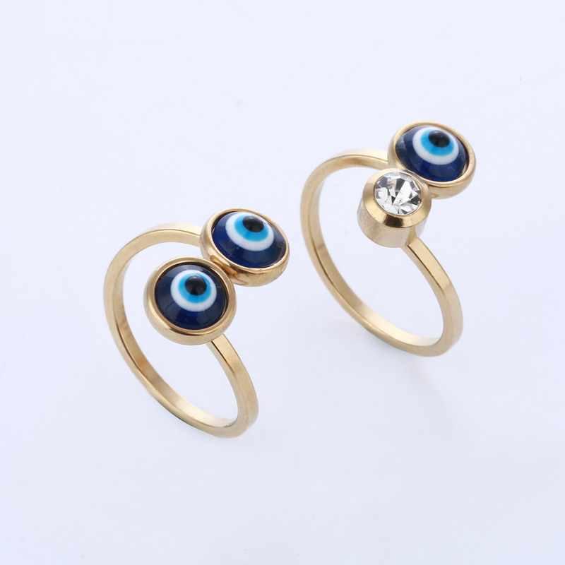 สง่างามน่ารักBlue Eyeแหวนสแตนเลสเพทายสำหรับผู้หญิงสุภาพสตรีหงส์สีทองเสน่ห์โชคดีตาเครื่องประดับพรรคแหวนของขวัญ