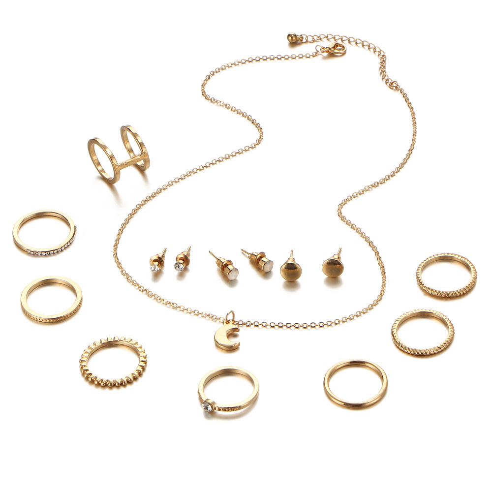 A set of Punk Style Ornaments accessory Suit containing a moon necklace,3 pairs of Ear Studs and 8 rings