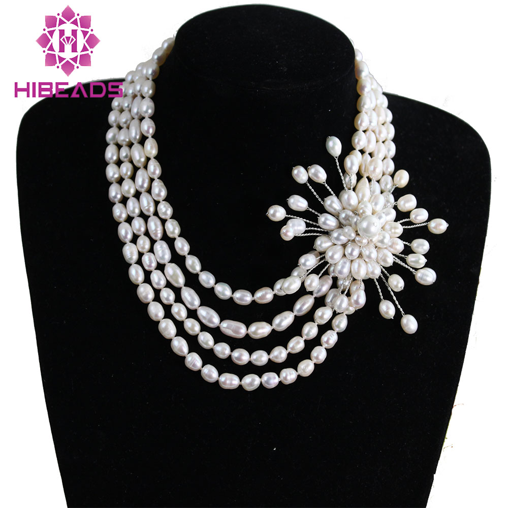 где купить Free Shipping 4 Rows Rice Natural Freshwater Pearls Necklace with Pearls Flower Pendant Wedding Necklace FP238 по лучшей цене