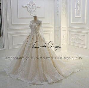 Image 3 - فستان زفاف عالي الجودة بأكمام طويلة مزين باللؤلؤ الشامبانيا بتصميم أماندا