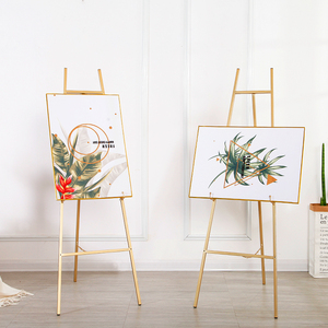 Image 2 - Golden Easel Wedding Banquet Easel Caballete De Pintura Metal Picture Stand Photo Display Frame Nordic Style Oil Painting Stand
