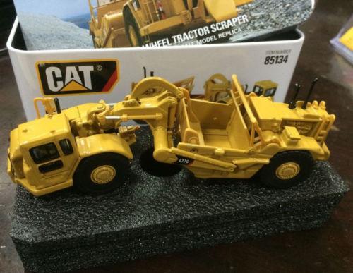 HO échelle DM modèle Caterpillar 627G roue tracteur grattoir cat 85134 nouveau
