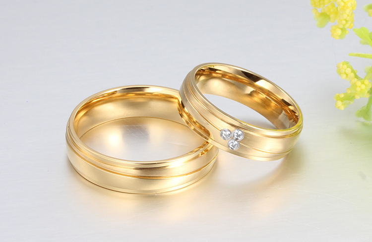 alibaba express factory price sale gold plating stainless steel couple ring set 2pcs couple wedding rings in rings from jewelry accessories on - Wedding Rings Gold